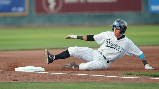 Idaho Falls Chukars short stop Marten Gasparini slides into third base during the last home game of the season against the Ogden Raptors Thursday at Melaleuca Field.  Photographer Pat Sutphin / psutphin@postregister.com, Date 9/4/2014, Lens 300, ISO 500, FStop {fstop}, Shutter 1/500, Aperature {aperature},